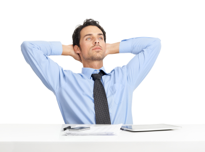 Relaxed young businessman sitting at his desk